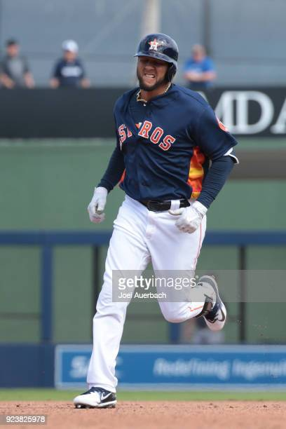 Yuli Gurriel of the Houston Astros rounds the bases after hitting a solo home fun against the Atlanta Braves during a spring training game at The...