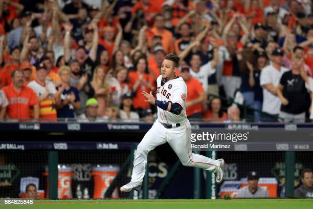 Yuli Gurriel of the Houston Astros runs home to score off of a double hit by Brian McCann against Tommy Kahnle of the New York Yankees during the...