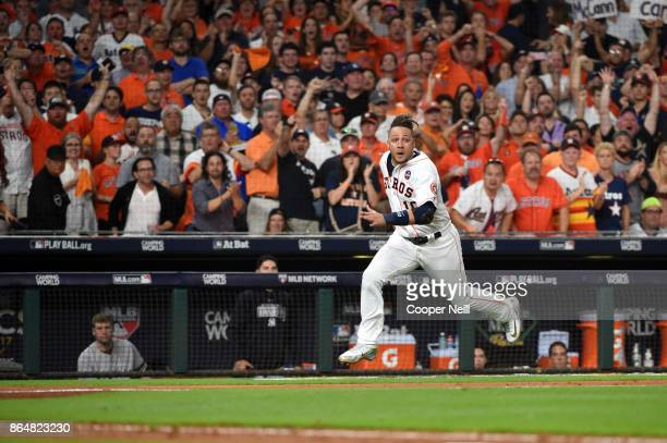 Yuli Gurriel of the Houston Astros runs home to score on the twoRBI double hit by Brian McCann in the fifth inning of Game 7 of the American League...