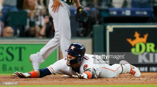 Yuli Gurriel of the Houston Astros scores in the second inning on his inside-the-park home run against the Oakland Athletics at Minute Maid Park on...