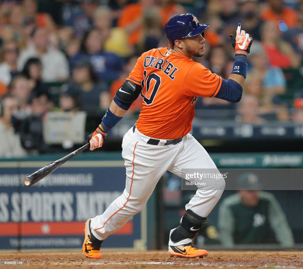 Yuli Gurriel #10 of the Houston Astros singles in the sixth inning against the Oakland Athletics at Minute Maid Park on August 18, 2017 in Houston, Texas.