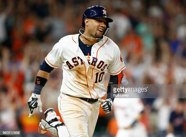 Yuli Gurriel of the Houston Astros singles in the winning run in the ninth inning against the Chicago White Sox at Minute Maid Park on July 5 2018 in...