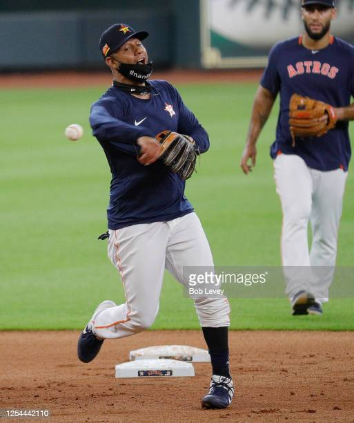Yuli Gurriel of the Houston Astros throws to first base during drills on the third day of Summer Camp workouts at Minute Maid Park on July 05, 2020...
