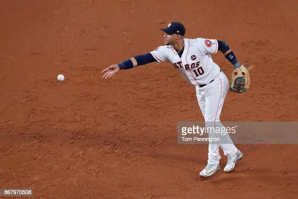 Yuli Gurriel of the Houston Astros tosses the ball during the third inning against the Los Angeles Dodgers in game five of the 2017 World Series at...