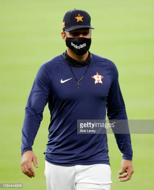 Yuli Gurriel of the Houston Astros wears a mask during warm-ups on the third day of Summer Camp workouts at Minute Maid Park on July 05, 2020 in...