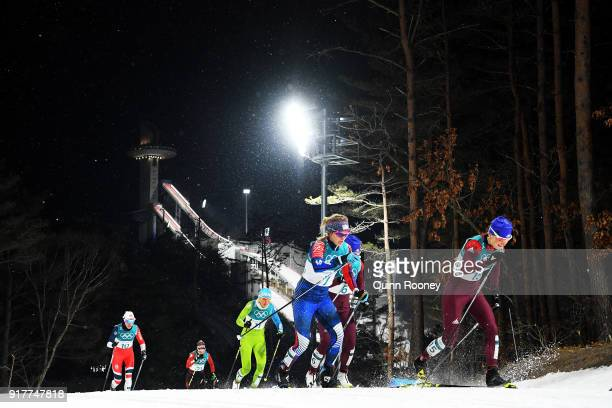 Yulia Belorukova of Olympic Athlete from Russia leads Jessica Diggins of the United States during the CrossCountry Ladies' Sprint Classic Semifinal...