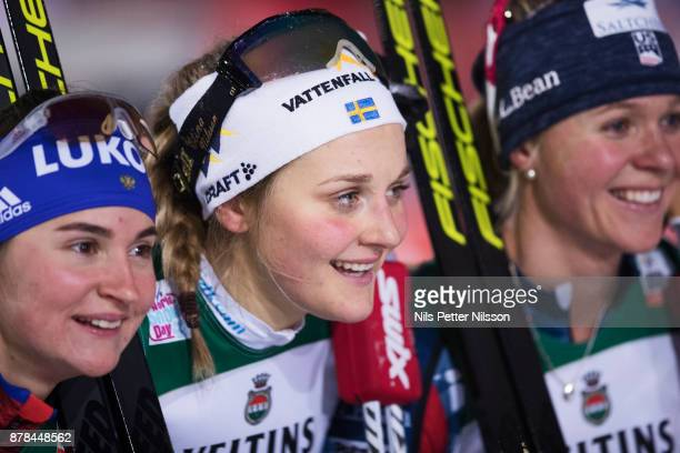 Yulia Belorukova of Russia Stina Nilsson of Sweden and Sadie Bjornsen of USA celebrates after the cross country sprint finals during the FIS World...