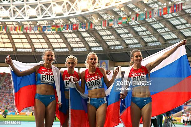 Yulia Gushchina Tatyana Firova Kseniya Ryzhova and Antonina Krivoshapka of Russia celebrate winning gold in the Women's 4x400 metres relay final...