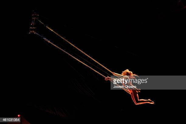 Yulia Korosteleva performs the solo trapeze act during the dress rehearsal for 'Kooza' by Cirque Du Soleil' at Royal Albert Hall on January 4 2015 in...