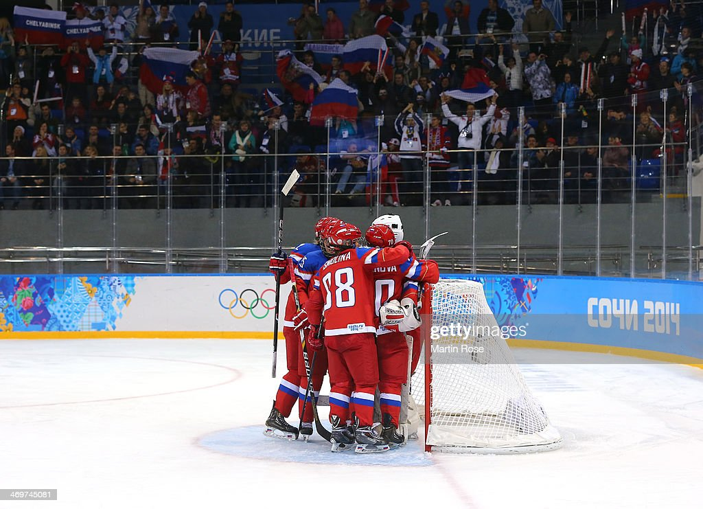 Yulia Leskina #20 of Russia celebrates with Angelina Goncharenko #2, Yekaterina Lebedeva #25 and Anna Shibanova #70 after defeating Japan 6-3 during the Women's Ice Hockey Classification game on day nine of the Sochi 2014 Winter Olympics at Shayba Arena on February 16, 2014 in Sochi, Russia.
