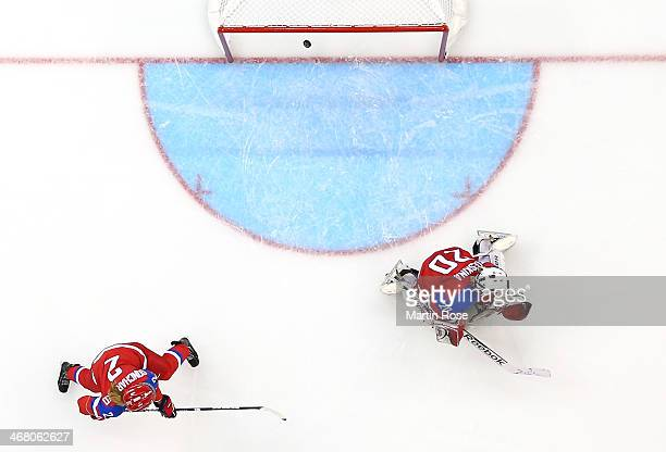 Yulia Leskina of Russia gives up a goal to Franziska Busch of Germany in the second period during the Women's Ice Hockey Preliminary Round Group B...