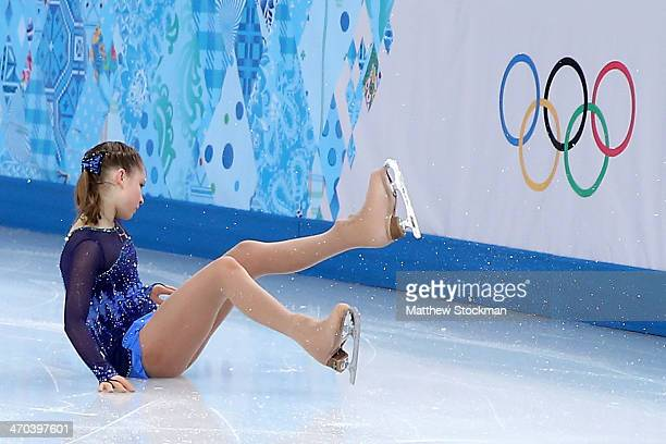 Yulia Lipnitskaya of Russia falls while competing in the Figure Skating Ladies' Short Program on day 12 of the Sochi 2014 Winter Olympics at Iceberg...