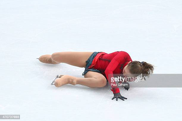 Yulia Lipnitskaya of Russia falls while competing in the Figure Skating Ladies' Free Skating on day 13 of the Sochi 2014 Winter Olympics at Iceberg...