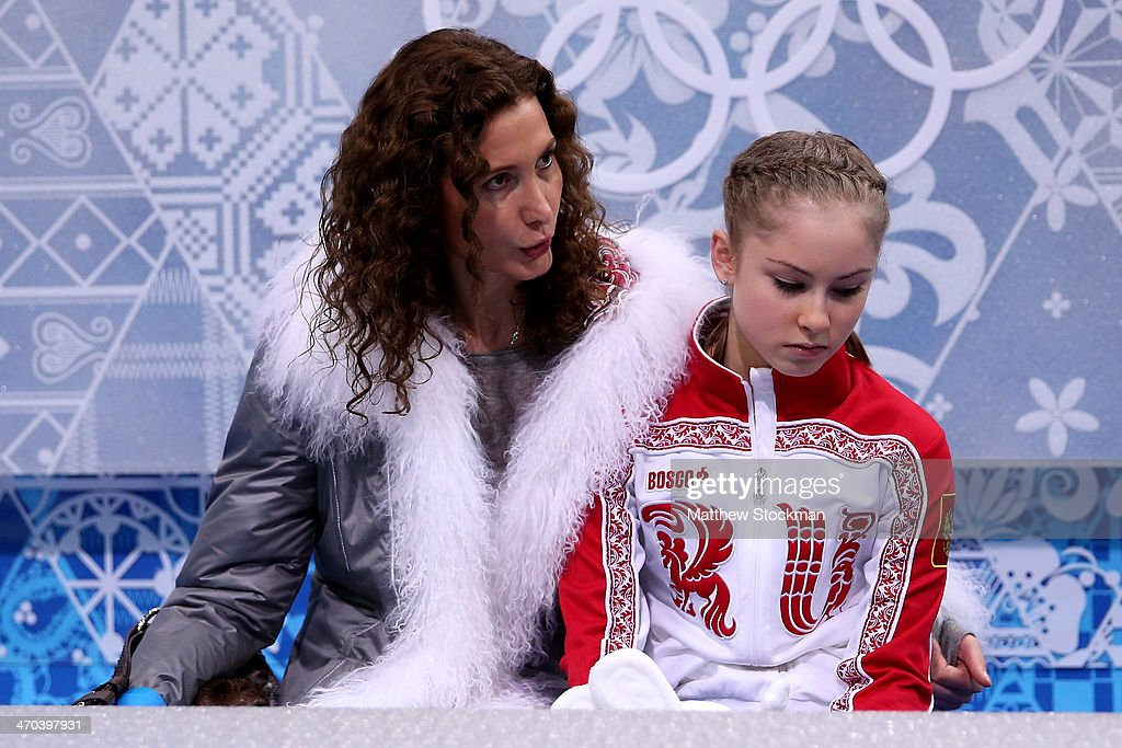 Yulia Lipnitskaya (R) of Russia waits for her score with her coach Eteri Tutberidze in the Figure Skating Ladies' Short Program on day 12 of the Sochi 2014 Winter Olympics at Iceberg Skating Palace on February 19, 2014 in Sochi, Russia.
