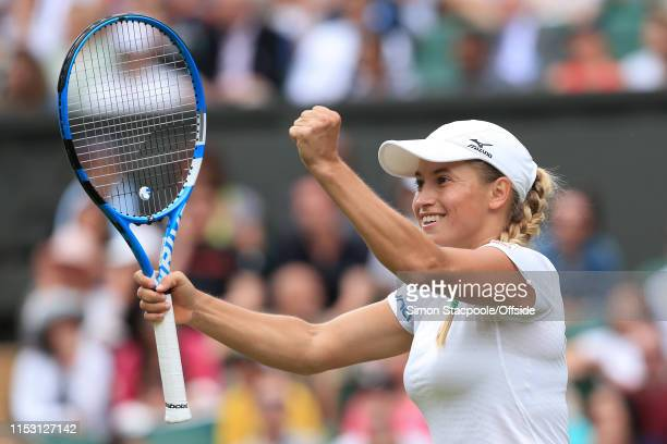 Yulia Putintseva celebrates victory over Naomi Osaka after their Ladies Singles 1st Round match on Day 1 of The Championships Wimbledon 2019 at the...