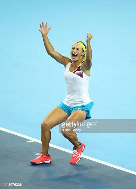 Yulia Putintseva of Kazakhstan celebrates defeating Katie Boulter of Great Britain during the Fed Cup World Group II Play-Off match between Great...