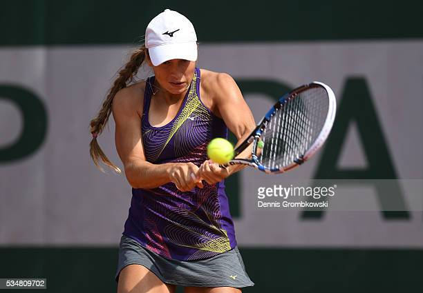 Yulia Putintseva of Kazakhstan hits a backhand during the Ladies Singles third round match against Karin Knapp of Italy on day seven of the 2016...