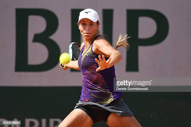 Yulia Putintseva of Kazakhstan hits a forehand during the Ladies Singles third round match against Karin Knapp of Italy on day seven of the 2016...