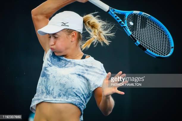 Yulia Putintseva of Kazakhstan hits a return against Donna Vekic of Croatia during the women's singles match on day two of the Brisbane International...