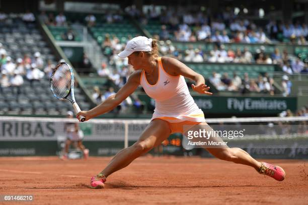 Yulia Putintseva of Kazakhstan plays a backhand during her Women's single match against Garbine Muguruza of Spain on day six of the 2017 French Open...