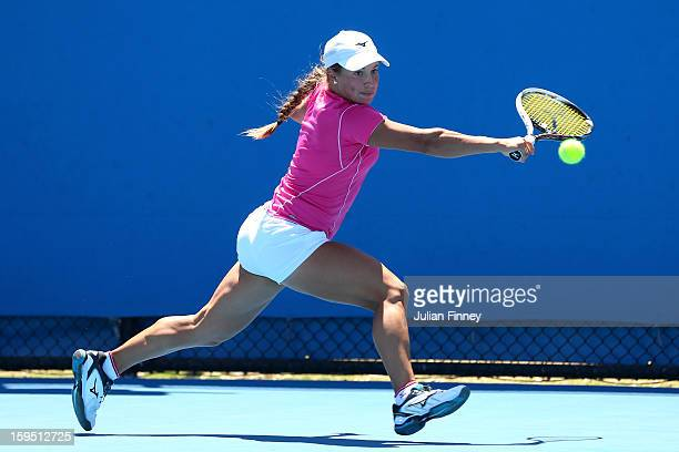 Yulia Putintseva of Kazakhstan plays a backhand in her first round match against Christina McHale of the United States during day two of the 2013...