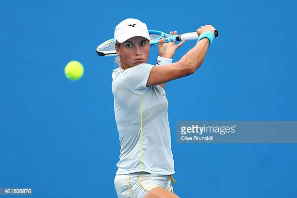 Yulia Putintseva of Kazakhstan plays a backhand in her first round match against Elina Svitolina of the Ukraine during day two of the 2015 Australian...