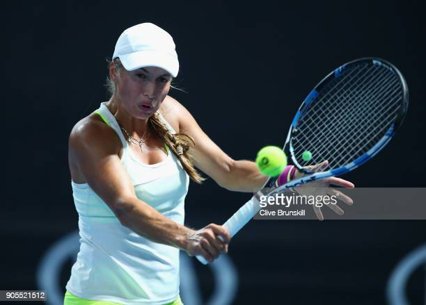 Yulia Putintseva of Kazakhstan plays a backhand in her first round match against Heather Watson of Great Britain on day two of the 2018 Australian...