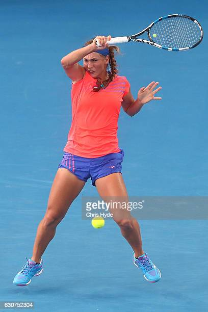 Yulia Putintseva of Kazakhstan plays a forehand in her first round match against Karolina Pliskova of the Czech Republic during day one of the 2017...