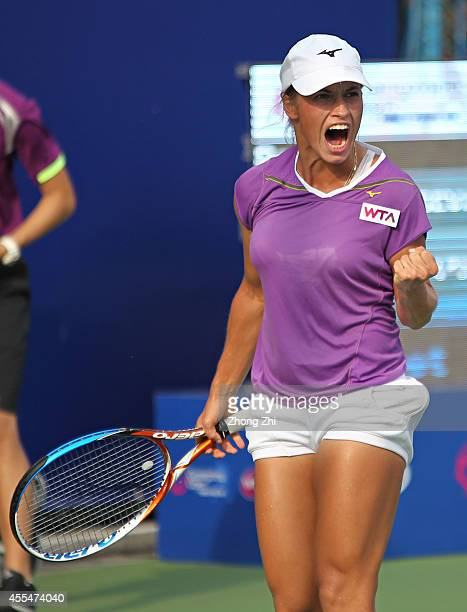 Yulia Putintseva of Kazakhstan reacts during her match against Alize Conrnet of France during day one of the 2014 WTA Guangzhou Open at Taint Sports...