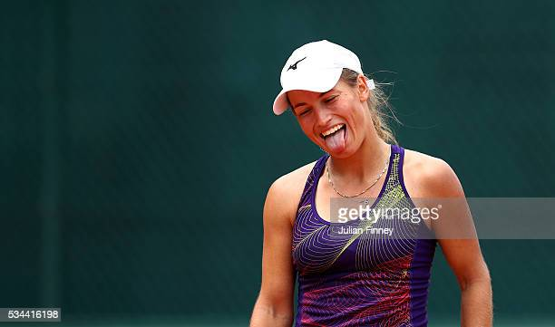 Yulia Putintseva of Kazakhstan reacts during the Ladies Singles second round match against Andrea Petkovic of Germany on day five of the 2016 French...