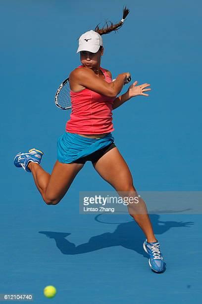 Yulia Putintseva of Kazakhstan returns a shot against Garbine Muguruza of Spain during the Women's singles second round match on day three of the...