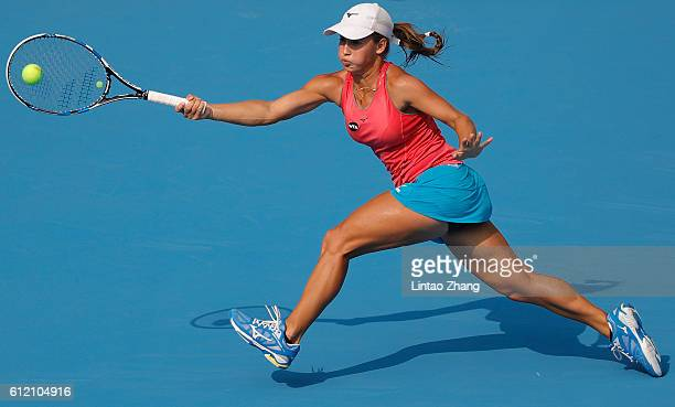 Yulia Putintseva of Kazakhstan returns a shot against Garbine Muguruza of Spain during the Women's singles second round match on day three of the...