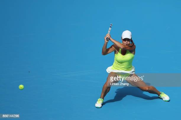 Yulia Putintseva of Kazakhstan returns a shot against Zhang Shuai of China during the Women's singles first round match on day two of the 2017 China...