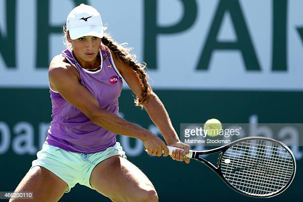 Yulia Putintseva of Kazakhstan returns a shot to Anna Ivanovic of Serbia during day six of the BNP Paribas Open at the Indian Wells Tennis Garden on...