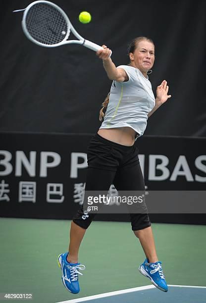 Yulia Putintseva of Kazakhstan returns to Misaki Doi of Japan at the International Tennis Federation Fed Cup Asia / Oceania group match in Guangdong...
