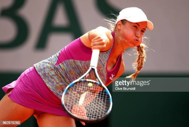 Yulia Putintseva of Kazhakstan serves during her singles first round match against Johanna Konta of Great Britain during day one of the 2018 French...