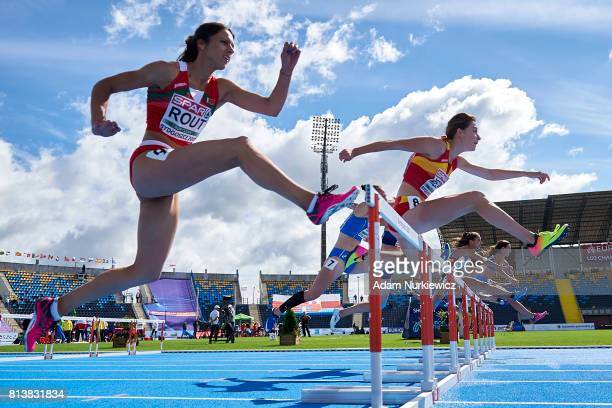Yulia Rout from Belarus and Andrea Medina from Spain compete at 100m hurdles during the Women's Heptathlon competition during day 1 of European...