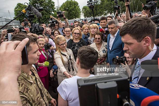Yulia Tymoshenko a member of parliament and leader of the Fatherland Party greets Ukrainian military pilot Nadiya Savchenko upon her arrival at Kyiv...