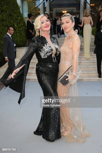 Yulia Yanina and her daughter Dasha Yanina arrive at the amfAR Gala Cannes 2018 at Hotel du CapEdenRoc on May 17 2018 in Cap d'Antibes France