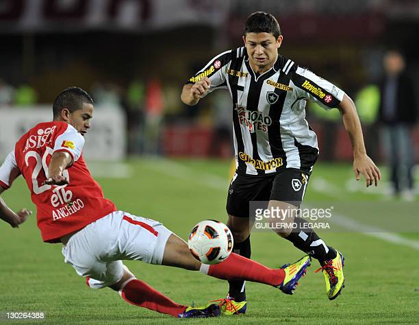 Yulian Anchico of Colombia's Independiente Santa Fe vies for the ball with Elkeson of Brazil's Botafogo during their Copa Sudamericana football match...