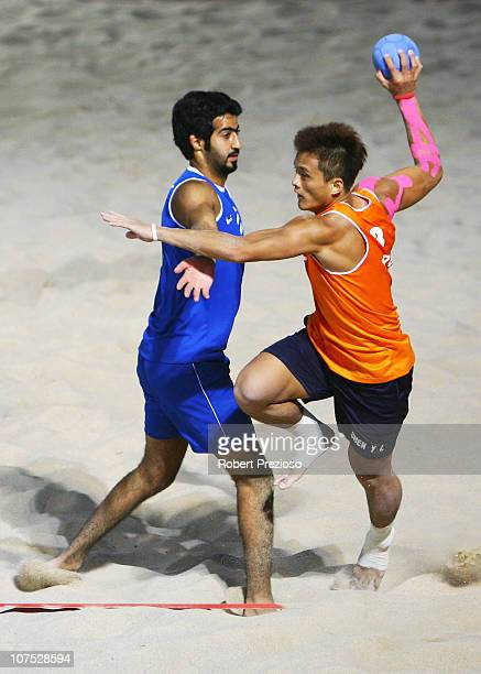 YuLiang Chen of Taipei and Nasser Jafar of Kuwait competes in the Men's Preliminary Round Beach Handball between Taipei and Kuwait at AlMusannah...