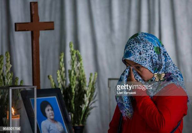 Yuliastuti, grieves in front of coffin of of Sri Puji, one of the victims killed at Surabaya Centre Pentecostal Church attack, following a blast at...