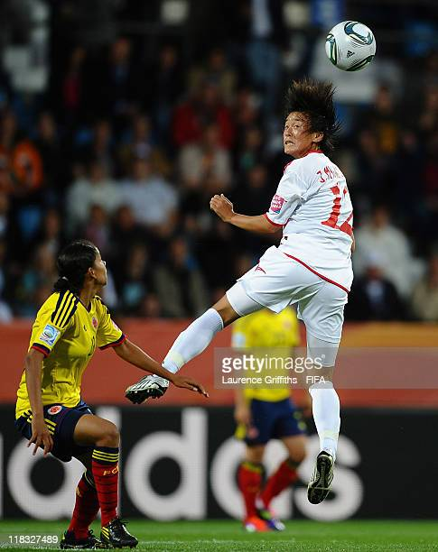Yulieht Dominguez of Colombia battles with Jon Myong Hwa of Korea DPR during the FIFA Women's World Cup 2011 match between Korea DPR and Colombia at...