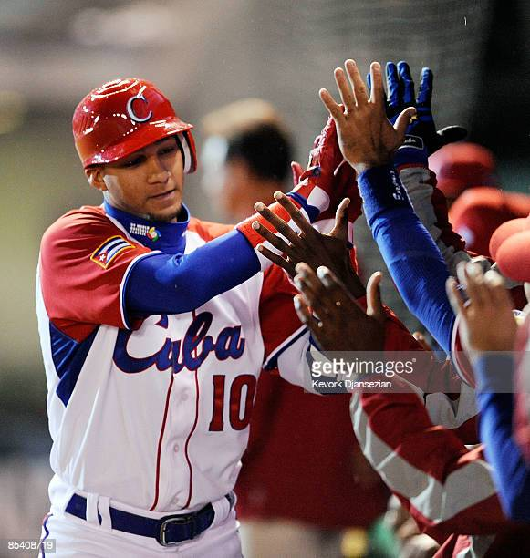 Yulieski Gourriel of Cuba celebrates his tworun home run against Mexico with his teammates during the 2009 World Baseball Classic Pool B match on...