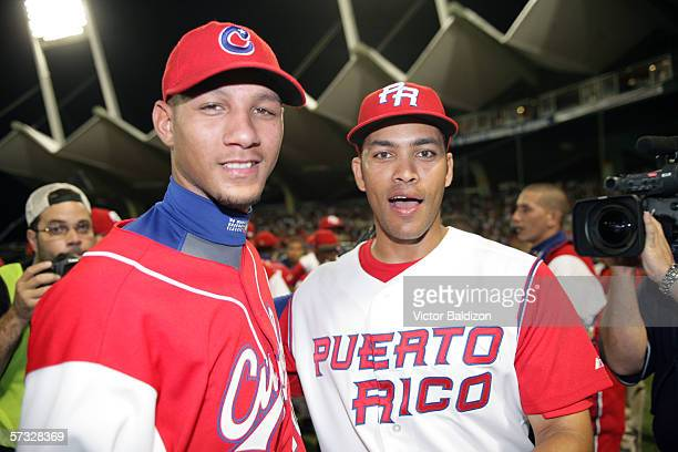 Yulieski Gourriel of Cuba is pictured with Jose Cruz Jr of Puerto Rico after the game on March 15 2006 at Hiram Bithorn Stadium in San Juan Puerto...