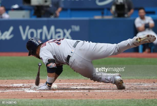 Yulieski Gurriel of the Houston Astros falls after being hit by pitch in the seventh inning during MLB game action against the Toronto Blue Jays at...