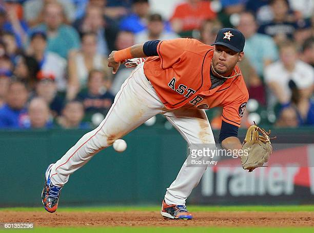 Yulieski Gurriel of the Houston Astros make a catch on a line drive off the bat of David Ross of the Chicago Cubs in the ninth inning at Minute Maid...