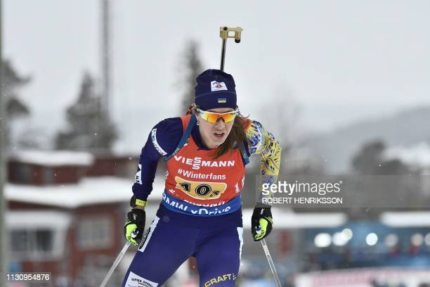 Yuliia Dzhima of Ukraine competes during the women's 4x6 km relay competition at the IBU World Biathlon Championships in Oestersund Sweden on March...