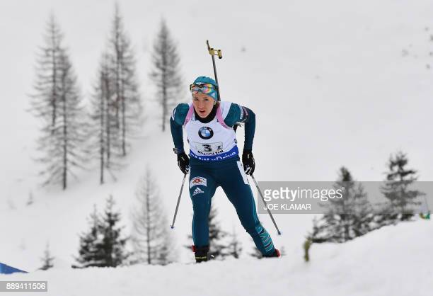 Yuliia Dzhima of Ukraine competes during the women's 4x6 km relay event at the IBU World Cup Biathlon in Hochfilzen Austria on December 10 2017 / AFP...