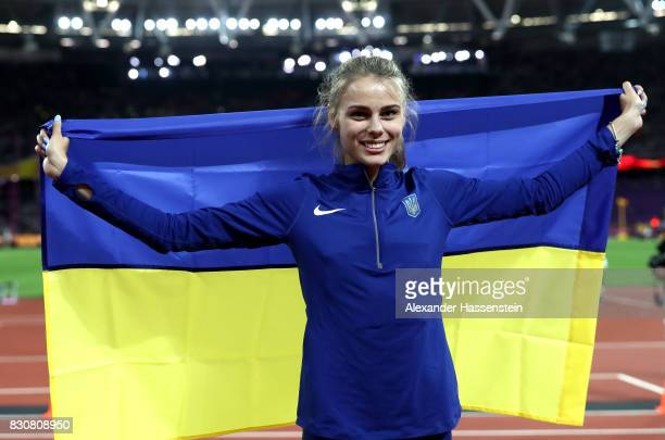 Yuliia Levchenko of Ukraine celebrates with a flag after winning silver in the Women's High Jump Final during day nine of the 16th IAAF World...